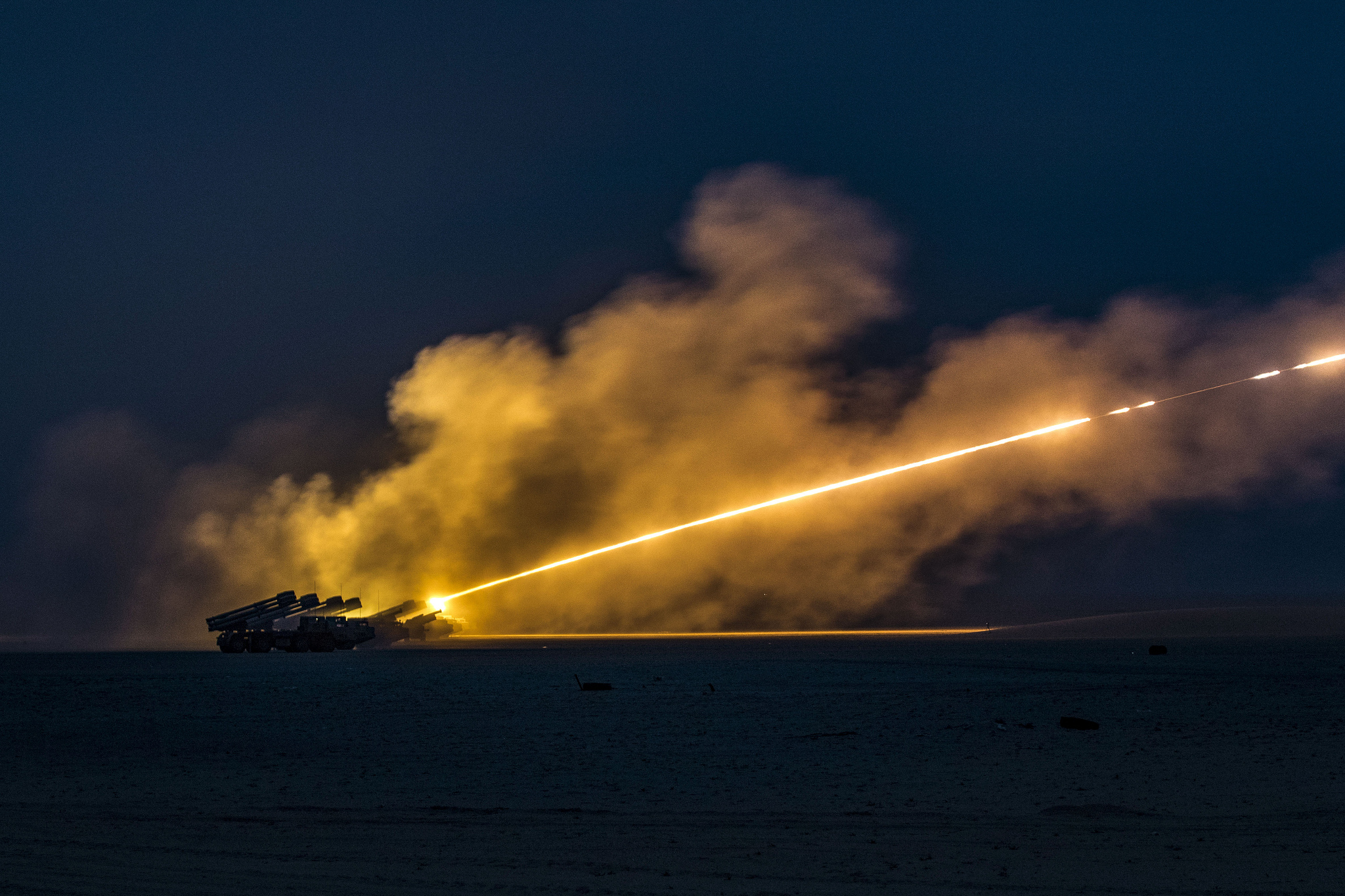 U.S. soldiers and soldiers with the Kuwait Land Forces fire their High Mobility Artillery Rocket Systems (U.S.) and BM-30 Smerch rocket systems (Kuwait) during a joint live-fire exercise on Jan. 8, 2019, near Camp Buehring, Kuwait. (Sgt. James Lefty Larimer/Army)