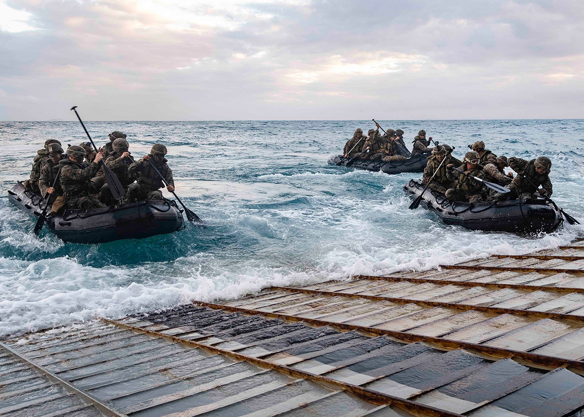 Marines launch in combat rubber raiding crafts from the stern gate of the amphibious dock landing ship USS Ashland (LSD 48) on July 3, 2019, in the Coral Sea. (Mass Communication Specialist 2nd Class Markus Castaneda/Navy)