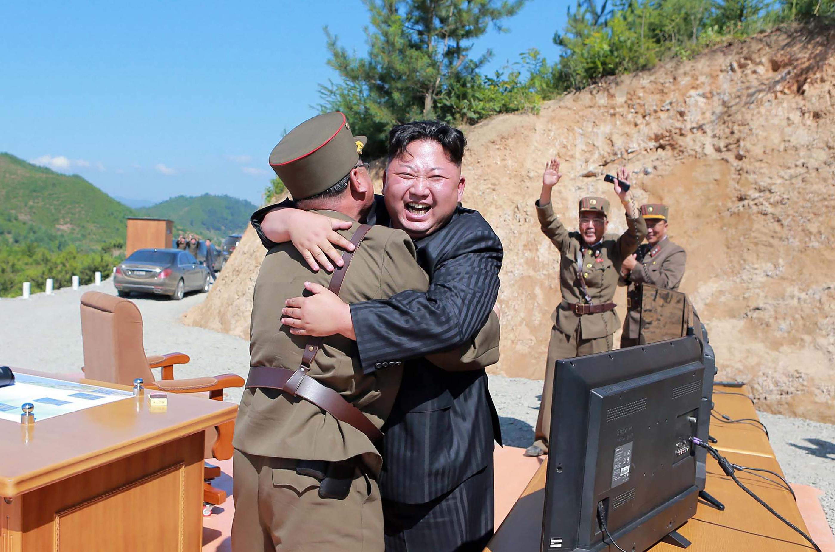 This picture taken on July 4, 2017 and released by North Korea's official Korean Central News Agency (KCNA) on July 5, 2017 shows North Korean leader Kim Jong-Un (C) celebrating the successful test-fire of the intercontinental ballistic missile Hwasong-14 at an undisclosed location. (AFP PHOTO/KCNA VIA KNS)