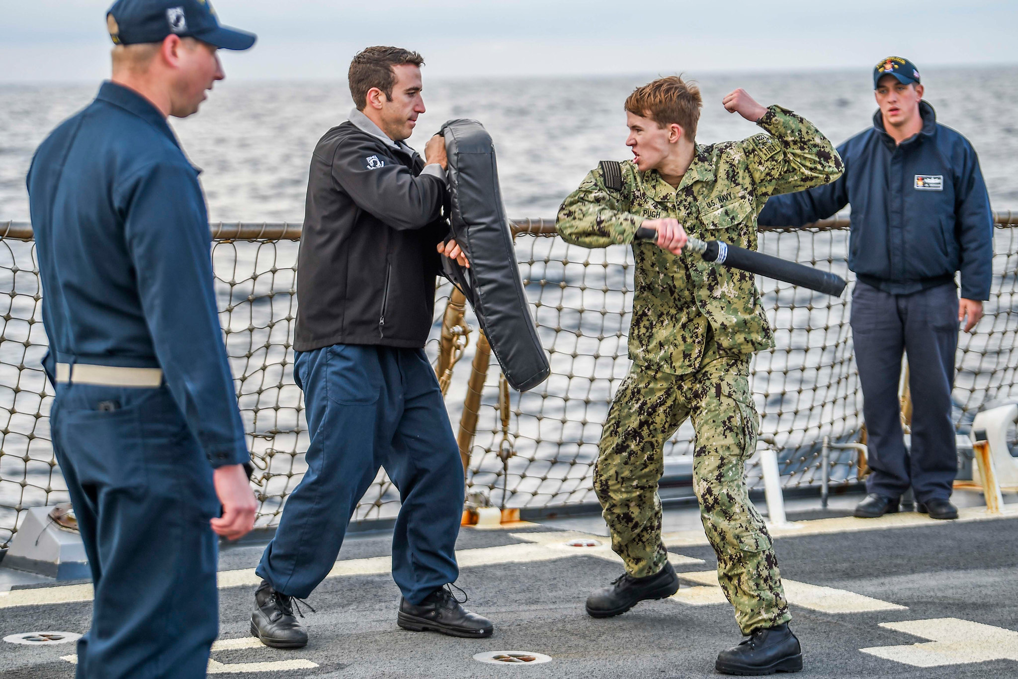Electronics Technician 3rd Class Philip Pugh participates in a non-lethal weapons and oleoresin capsicum spray training course on the flight deck of the Arleigh Burke-class guided-missile destroyer USS Milius (DDG 69) on Dec. 30, 2019, in the Sea of Japan. (Mass Communication Specialist 2nd Class Taylor DiMartino/Navy)
