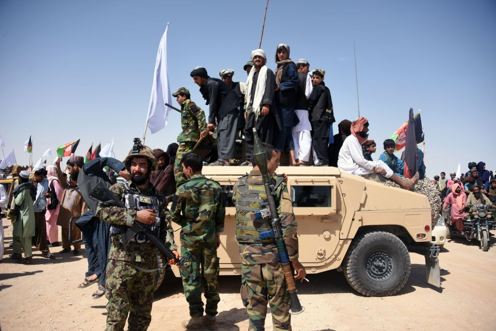Afghan Taliban militants and residents stand on an armored Humvee vehicle of the Afghan National Army as they celebrate a cease-fire on the third day of Eid. Though the cease-fire has ended, a U.S. official sees the three-day pause as a positive sign. (Javed Tanveer/AFP via Getty Images)