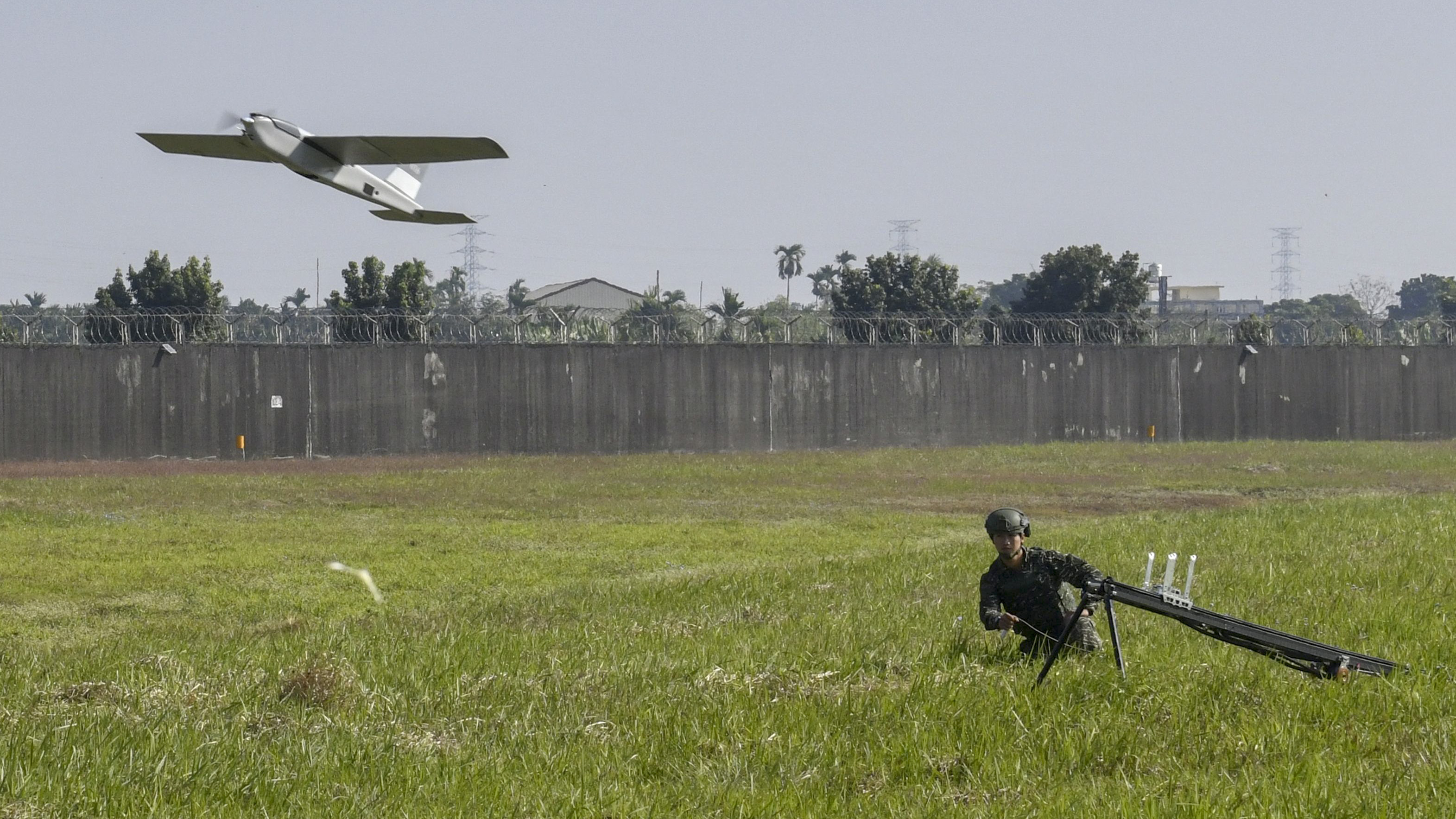 An indigenously-made Cardinal unmanned aerial vehicle (UAV) is launched by a navy serviceman during a military exercise at the Pingtung Air Force Base in southern Taiwan on January 24, 2019. (SAM YEH/AFP/Getty Images)