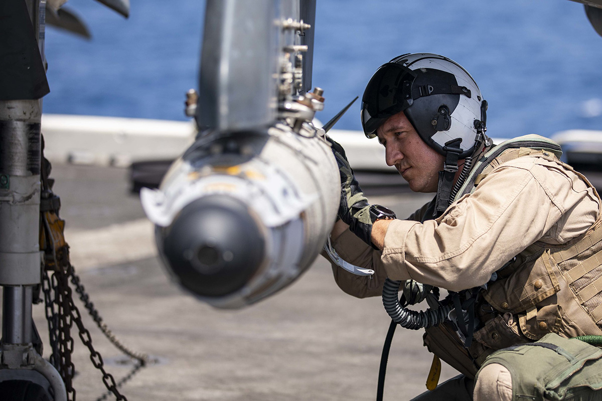 AV-8HB Harrier pilot Maj. Joseph Swindell inspects a GBU-54 joint direct attack munition during pre-flight checks May 20, 2019, on the flight deck of the Wasp-class amphibious assault ship USS Kearsarge (LHD 3) in the Arabian Sea. (Mass Communication Specialist 2nd Class Ryre Arciaga/Navy)