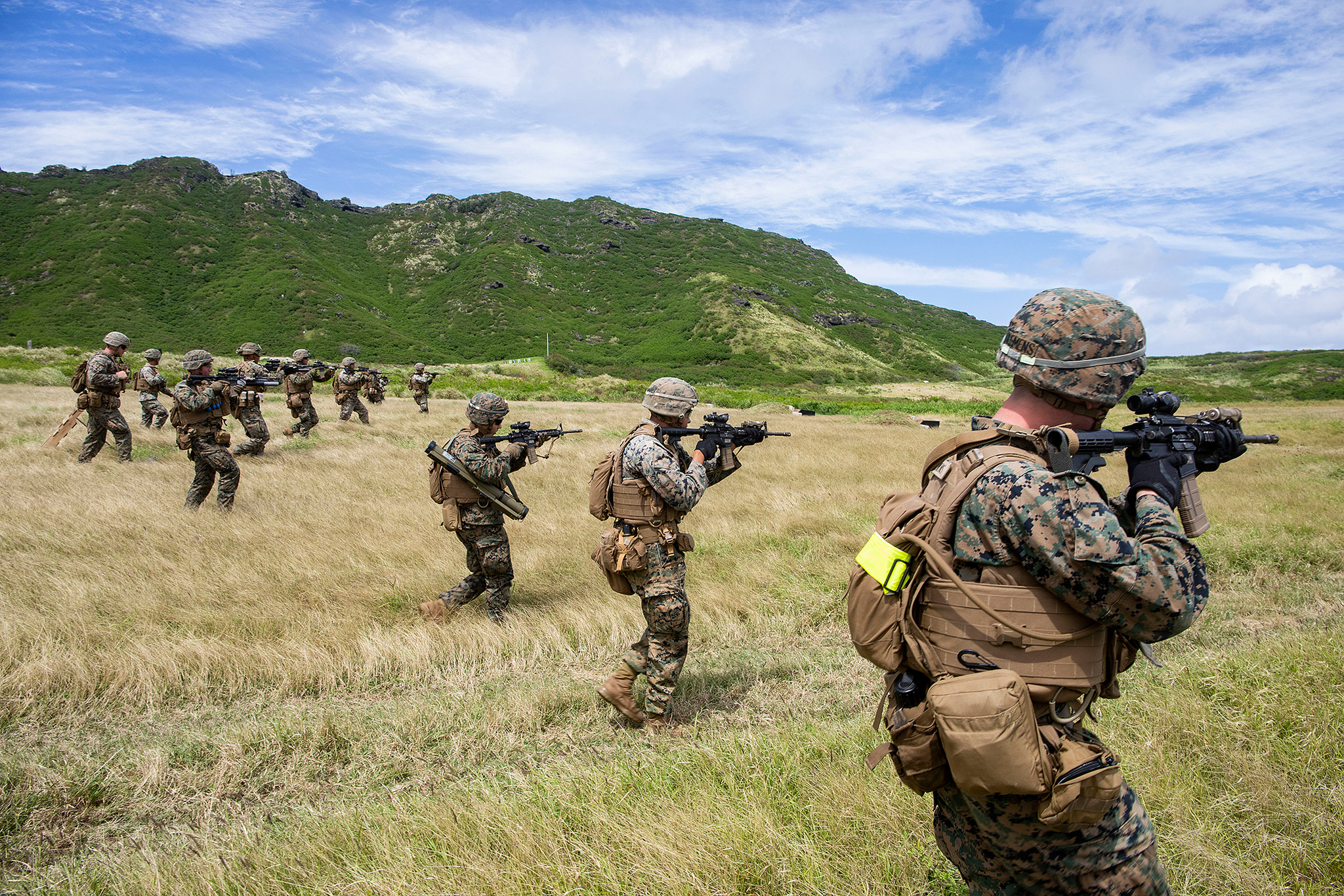 Marines advance toward targets on March 6, 2019, during a squad supported attack at the Kaneohe Bay Range Training Facility, Marine Corps Base Hawaii. (Sgt. Jesus Sepulveda Torres/Marine Corps)