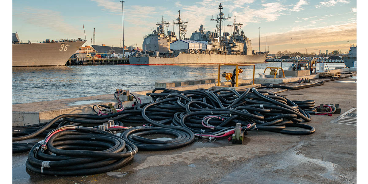 Naval Station, Norfolk - An empty berth and coiled shore power cables are all that's left after the guided-missile destroyer McFaul, departed on deployment. (Mark D. Faram/staff)