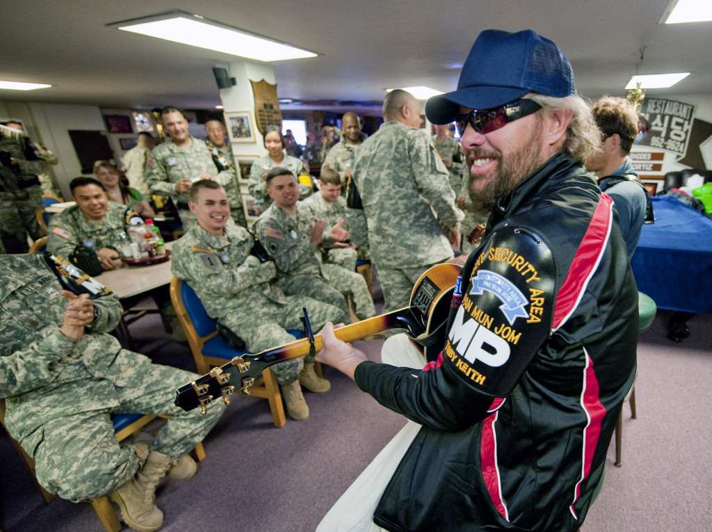 Toby Keith and singer/songwriter Scotty Emerick (behind Toby) put on an impromptu acoustic performance for troops in Korea, April 29, 2010. (Dave Gatley/USO)