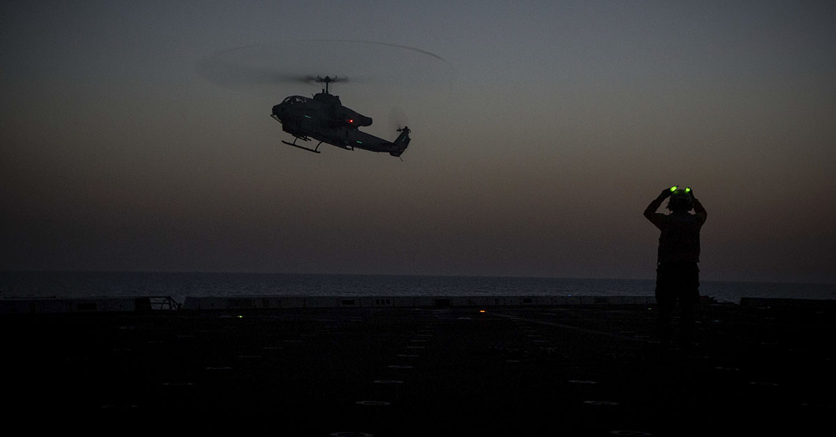 An AH-1YW Super Cobra helicopter, assigned to Marine Medium Tiltrotor Squadron (VMM) 162 (Reinforced), 26th Marine Expeditionary Unit (MEU), prepares to land on the San Antonio-class amphibious transport dock USS New York (LPD 21) June 29, 2018. The 26th MEU regularly rehearses day and night landings to maintain proficiency while deployed to the U.S. 6th Fleet area of operations. (Cpl. Juan A. Soto-Delgado/Marines)