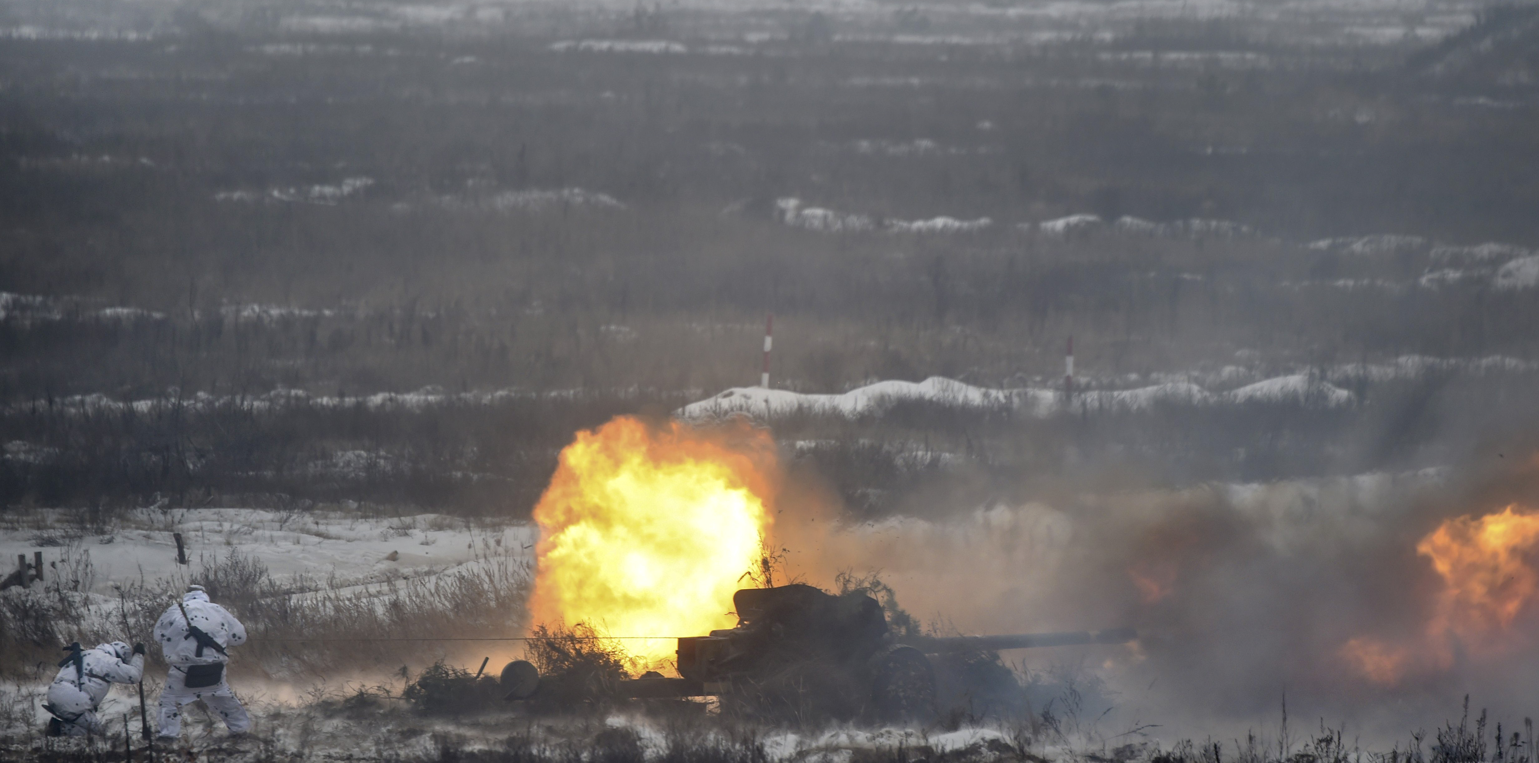 Ukrainian servicemen fire a gun as they take part in brigade tactical exercises with combat shooting near Goncharivske willage, Chernihiv region, not far from the border with Russia on December 3, 2018 - Tensions between Ukraine and Russia rose on November 25, when Russian forces seized three Ukrainian navy vessels and their crew. Ukraine imposed martial law for 30 days in 10 regions that border Russia, the Black Sea and the Azov Sea on November 28. (SERGEI SUPINSKY/AFP/Getty Images)