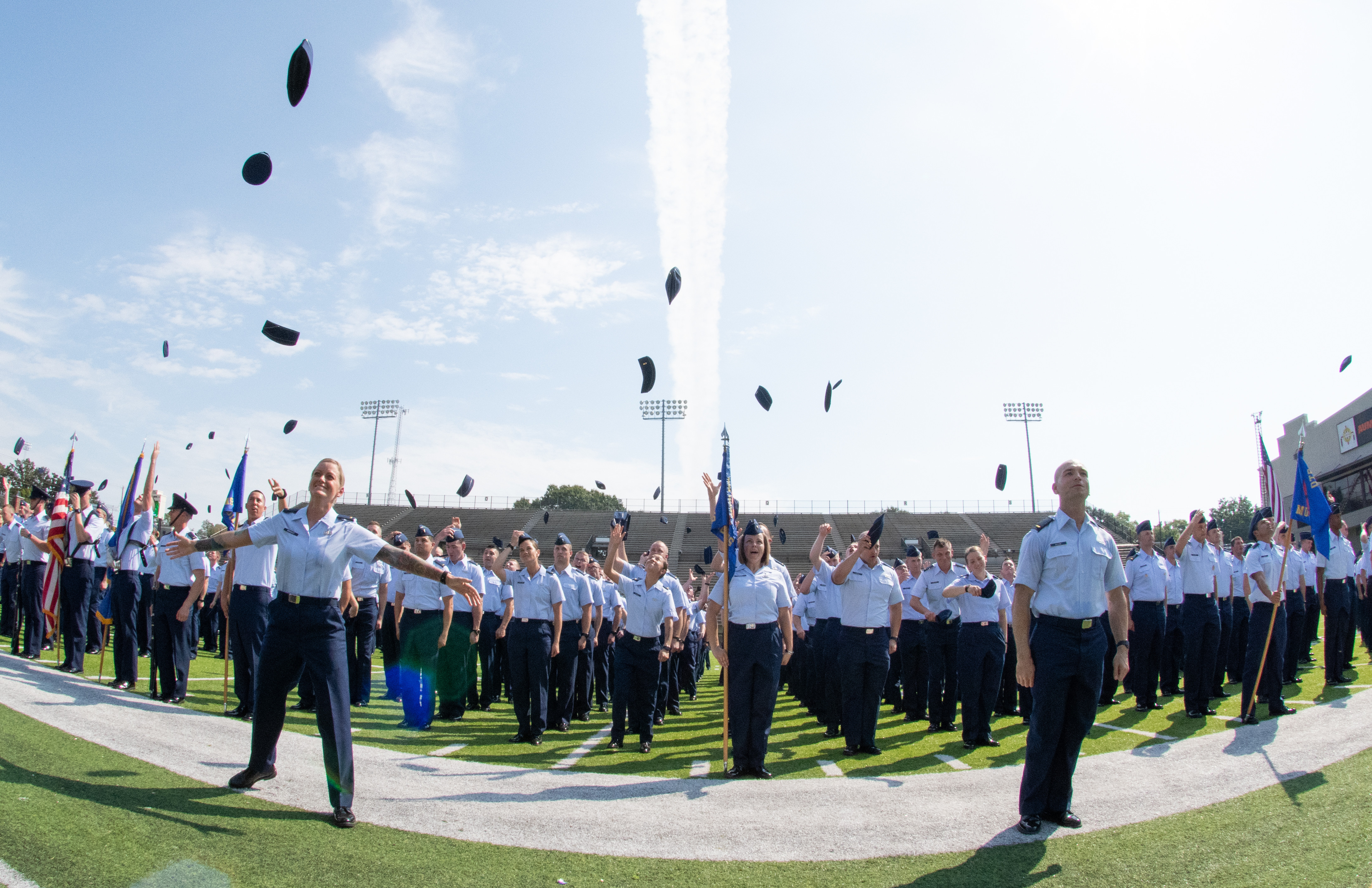 """The Air Force's newest commissioned officers a part of Officer Training School class 19-07 throw their flight caps in the air following their graduation ceremony Sept. 27, 2019, in Montgomery, Alabama. Officer Training School's class 19-07, or also known as """"Godzilla Class"""" is the school's largest class in history and pushed OTS to its maximum capacity. (Airman 1st Class Charles Welty/Air Force)"""