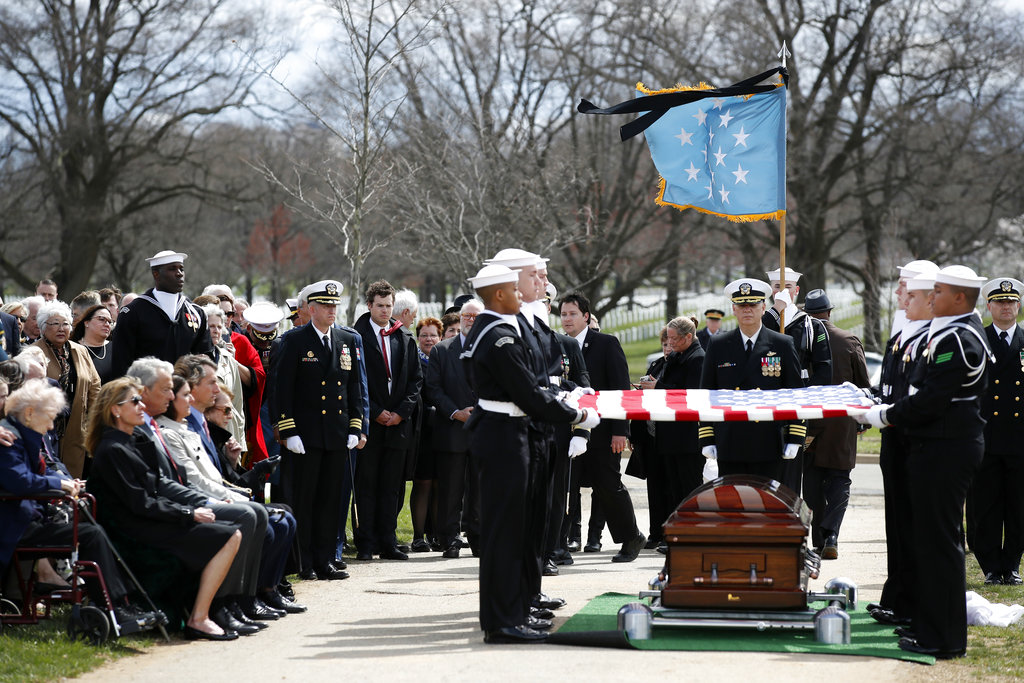 The casket team prepares to fold the flag during burial services for Capt. Thomas J. Hudner Jr., a naval aviator and Medal of Honor recipient from Concord, Mass., at Arlington National Cemetery Wednesday, April 4, 2018 in Arlington, Va. Hudner earned the Medal of Honor for his actions in the Battle of the Chosin Reservoir during the Korean War. (Alex Brandon/AP)