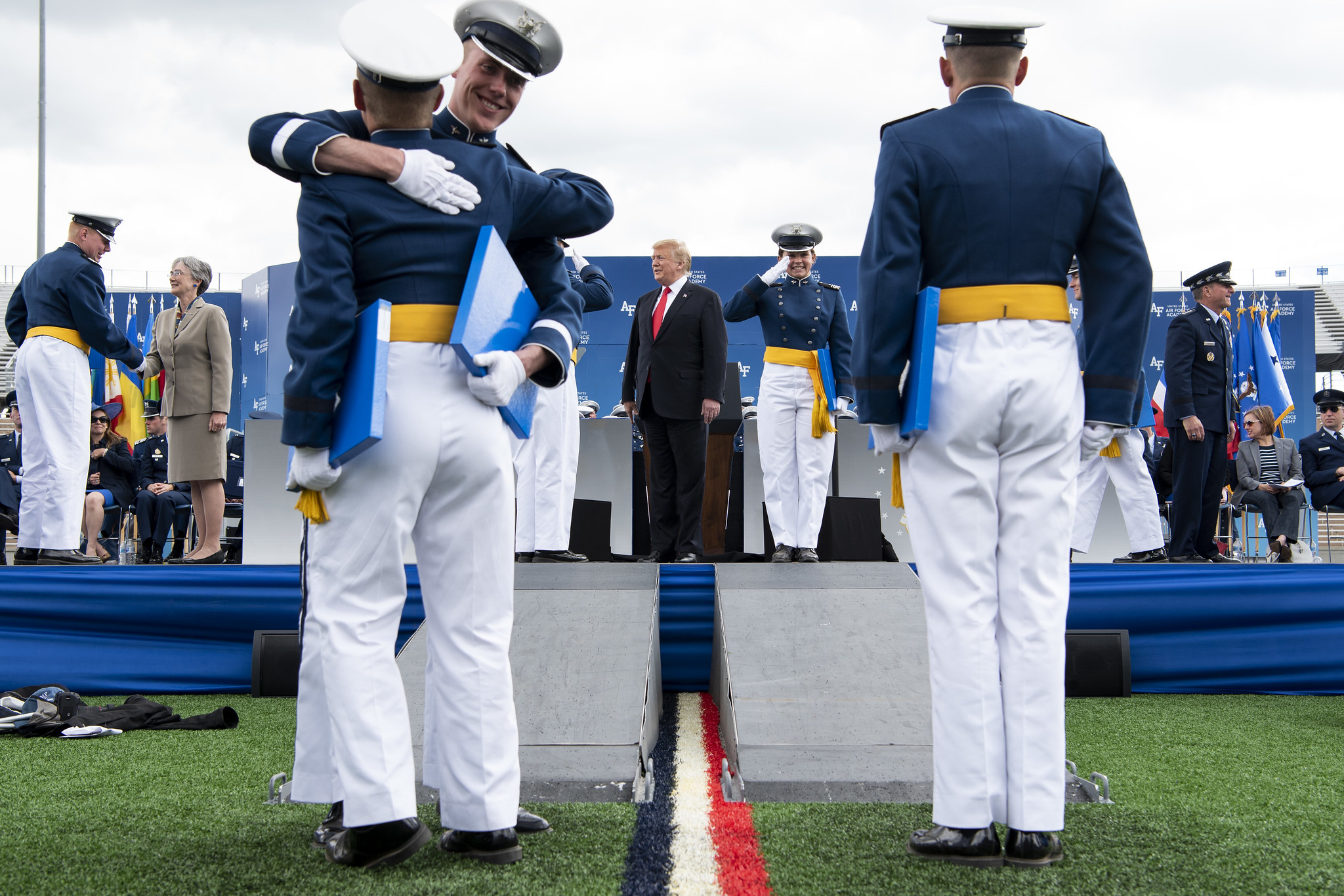 President Donald Trump congratulates cadets at the U.S. Air Force Academy graduation at Falcon Stadium in Colorado Springs, Colo., May 30, 2019. Nine-hundred-eighty-nine cadets graduated to become the newest 2nd lieutenants in the Air Force. (Joshua Armstrong/Air Force)