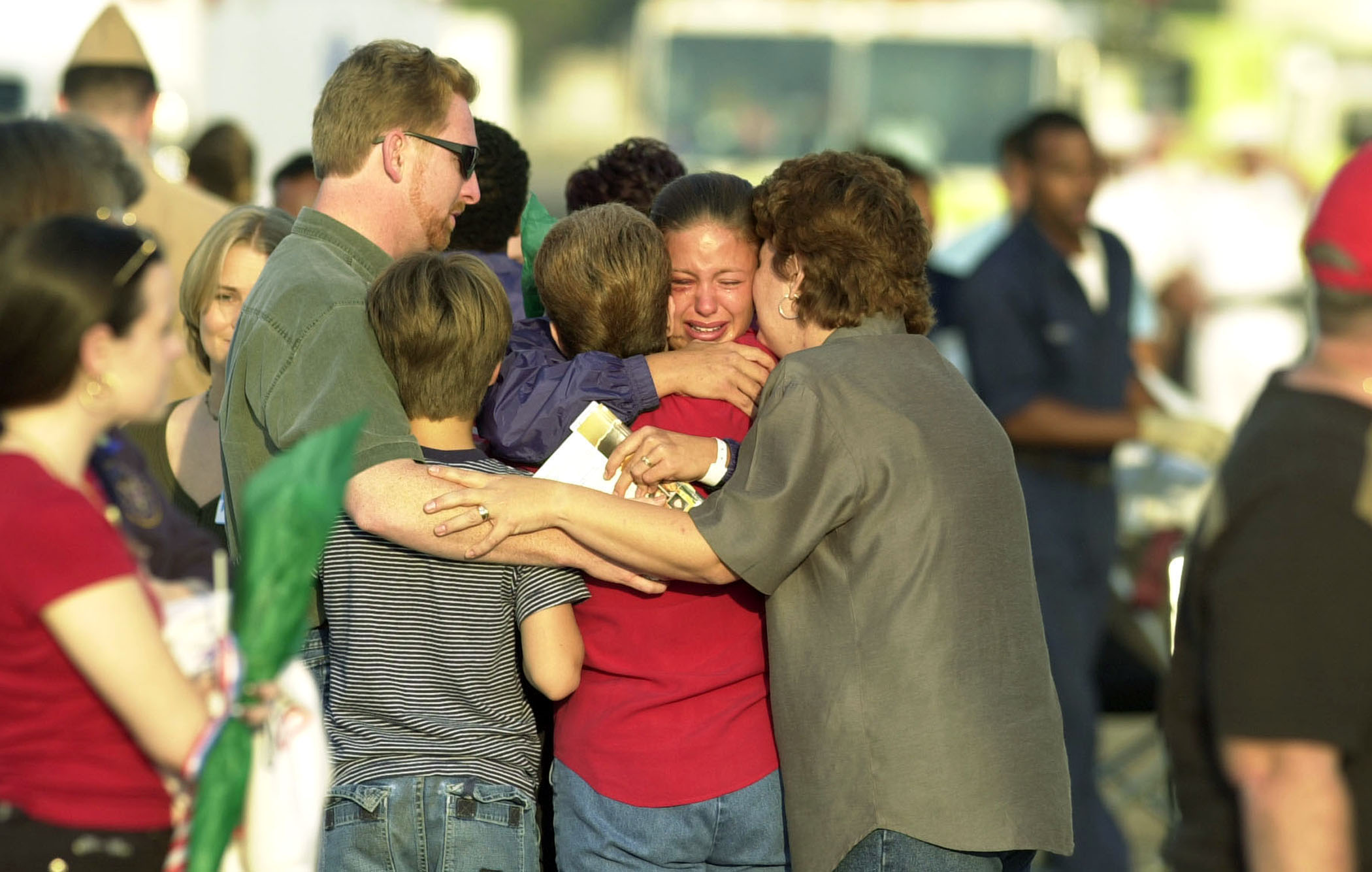 A sailor is reunited with her family at the Naval Air Station October 15, 2000 in Norfolk, VA. 33 Sailors were injured when a suspected terrorist bomb struck the U.S. Navy destroyer USS Cole October 12, 2000 (Navy Photo)