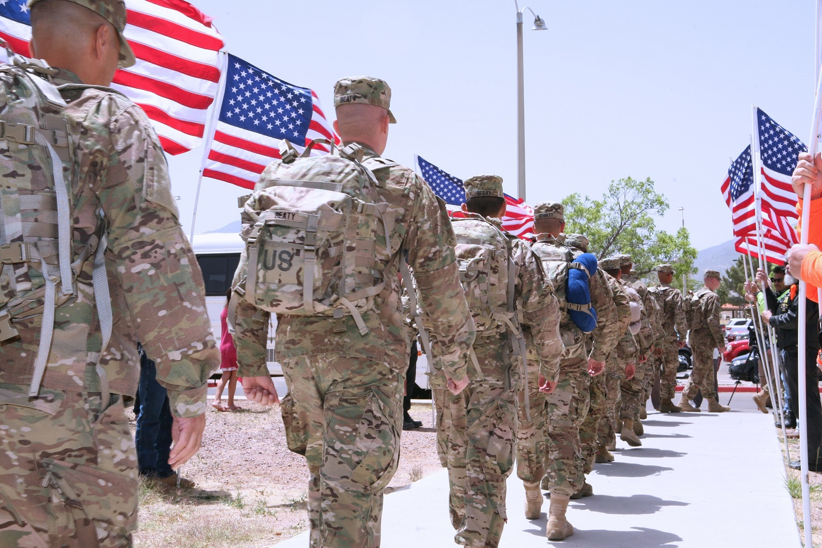 After saying goodbye to family and friends, soldiers from the 40th Expeditionary Signal Battalion march to the buses that will take them to the airfield, marking the start of their deployment to Afghanistan. (Maranda Flynn /Army)
