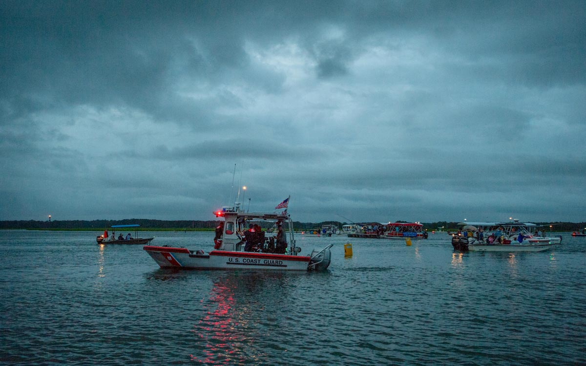 Chincoteague, Va. (July 25, 2018) Coast Guardsmen from Station Chincoteage arrive on station in the pre-dawn hours prior to the start of the Chincoteague annual pony swim. (photo by Joan Zopf-Faram/special)