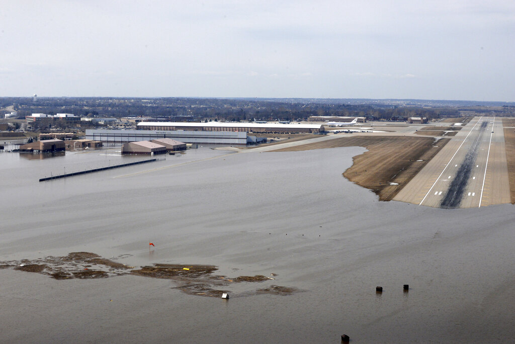 This March 17 photo released by the Air Force shows an aerial view of Offutt Air Force Base and the surrounding areas affected by flood waters in Nebraska. (Tech. Sgt. Rachelle Blake/Air Force via AP)