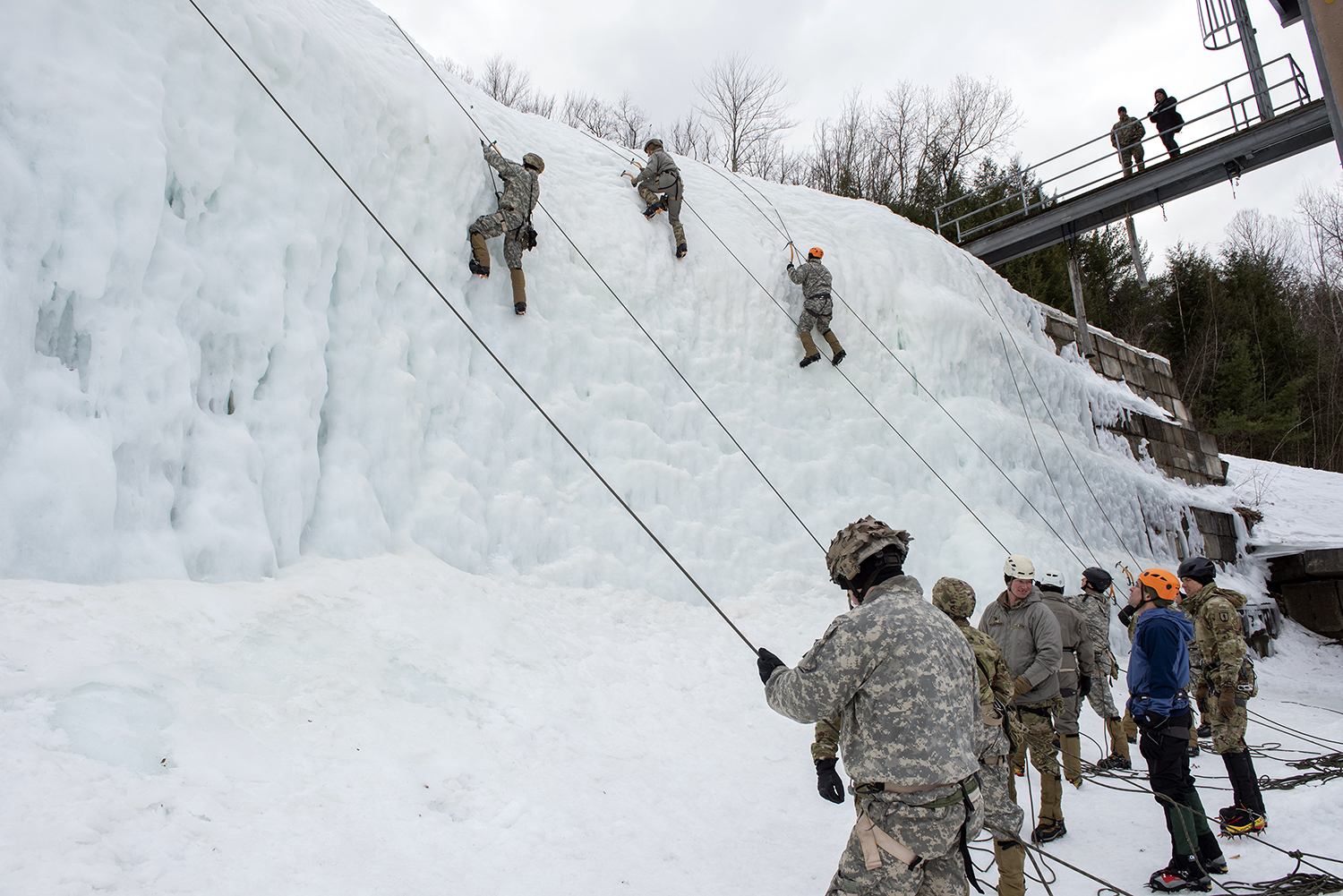 Secretary of the Army Dr. Mark T. Esper observes soldiers climbing an ice wall at the Army Mountain Warfare School on Camp Ethan Allen Training Site, Jericho, Vt., March 16, 2019. (Master Sgt. Sarah Mattison/Air National Guard)