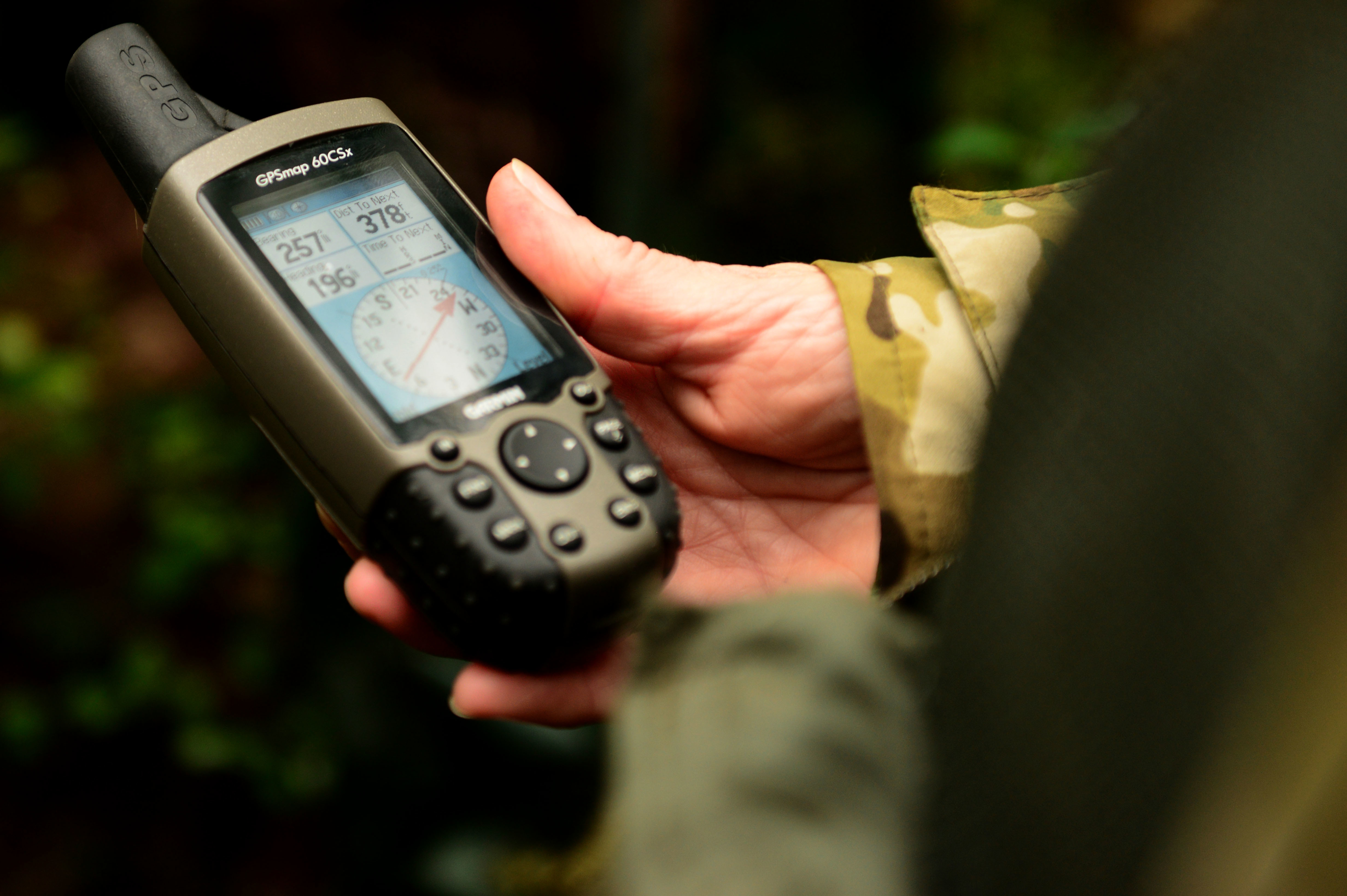 A U.S. airman uses a GPS to load coordinates at Langley Air Force Base, Va., on Nov. 19, 2015. Being able to use various types of technology during survival courses ensures airmen are prepared in the event of being stranded in the wilderness. (Airman 1st Class Derek Seifert/Air Force)
