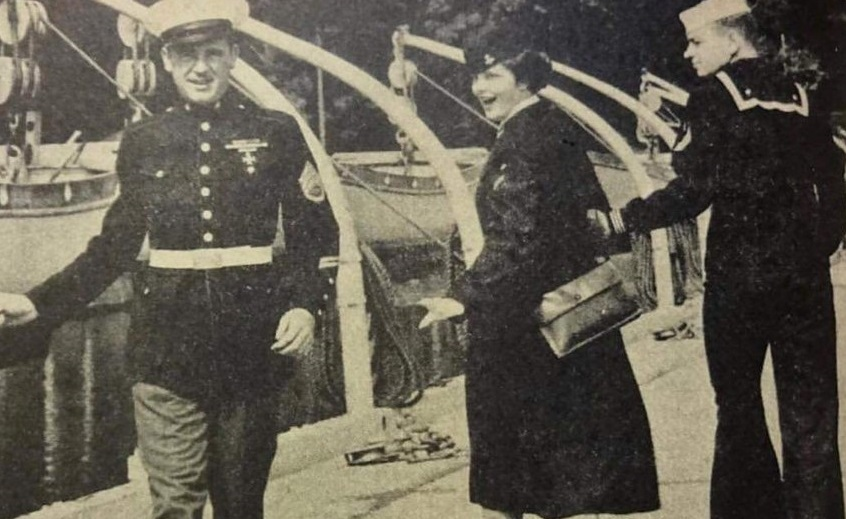 Long before the famous look-back meme, a heroic Marine drew the longing gaze of a woman in the arms of a sailor. (subreddit r/USMC)