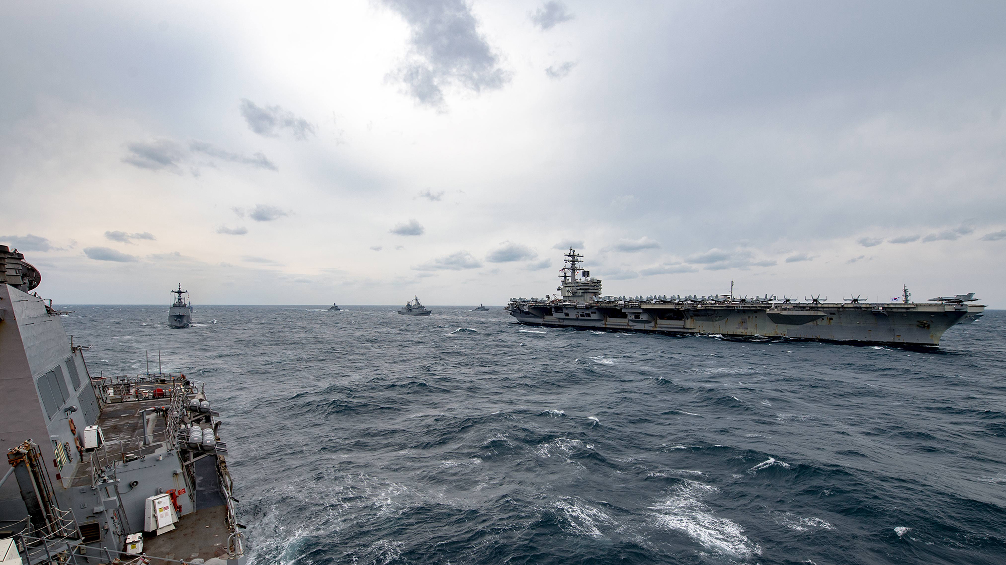 The forward-deployed Arleigh Burke-class guided-missile destroyer USS Stethem (DDG 63) joins Republic of Korea Navy ships for an exercise with the aircraft Carrier USS Ronald Reagan (CVN 76). Stethem is on patrol in the U.S. 7th Fleet area of operations in support of security and stability in the Indo-Asia Pacific region. (Specialist 2nd Class Jeremy Graham/Navy)