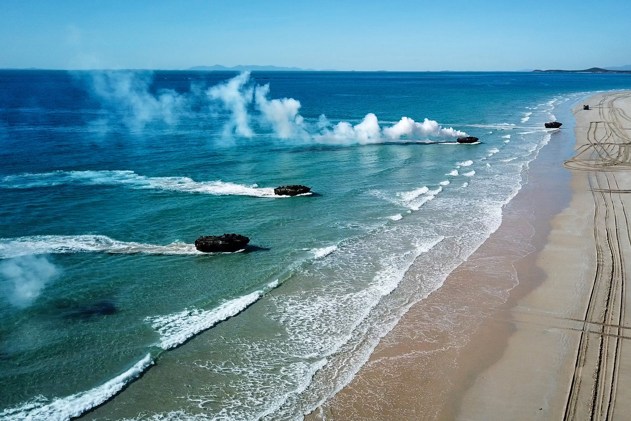 Amphibious assault vehicles approach Langham's Beach in Stanage Bay in Queensland, Australia, during a multinational amphibious landing July 16, 2019, as part of exercise Talisman Sabre 2019. (Australian Army)