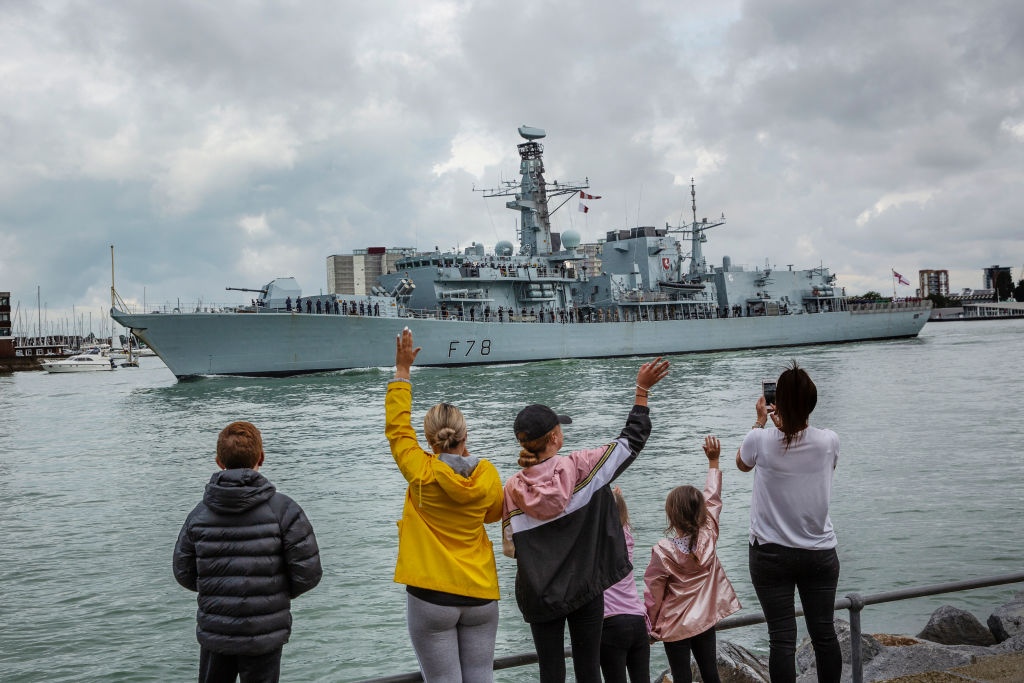 Families wave as HMS Kent, a Type 23 frigate leaves Portsmouth Harbour on August 12, 2019 in Portsmouth, England. The British warship is on route to the Gulf amid heightened tensions with Iran. (Photo by Dan Kitwood/Getty Images)