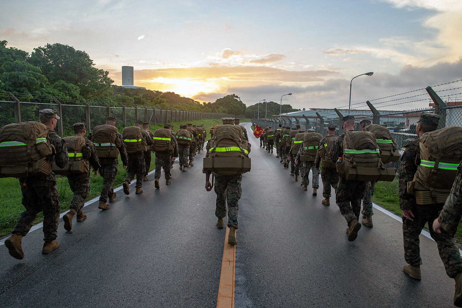 Marines participate in a 10 kilometer hike on Camp Hansen, Okinawa, Japan, July 12, 2019. (Lance Cpl. D'Angelo Yanez/Marine Corps)