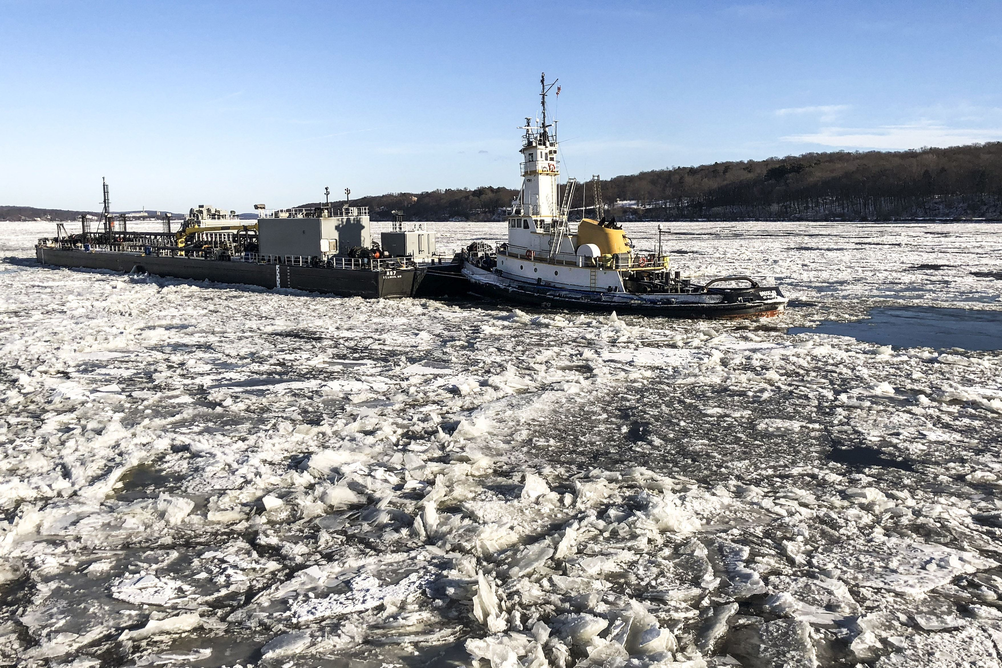 Coast Guard Cutter Penobscot Bay, an icebreaking tug, helps a tugboat break free from ice in the Hudson River near Saugerties, N.Y., Dec. 31, 2017. Coast Guard photo