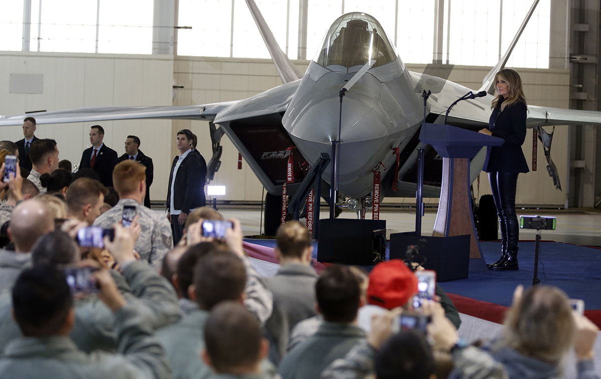 First lady Melania Trump speaks in front of an F-22 fighter jet during a tour of Joint Base Langley-Eustis in Hampton, Va., Wednesday, Dec. 12, 2018. (Steve Helber/AP)