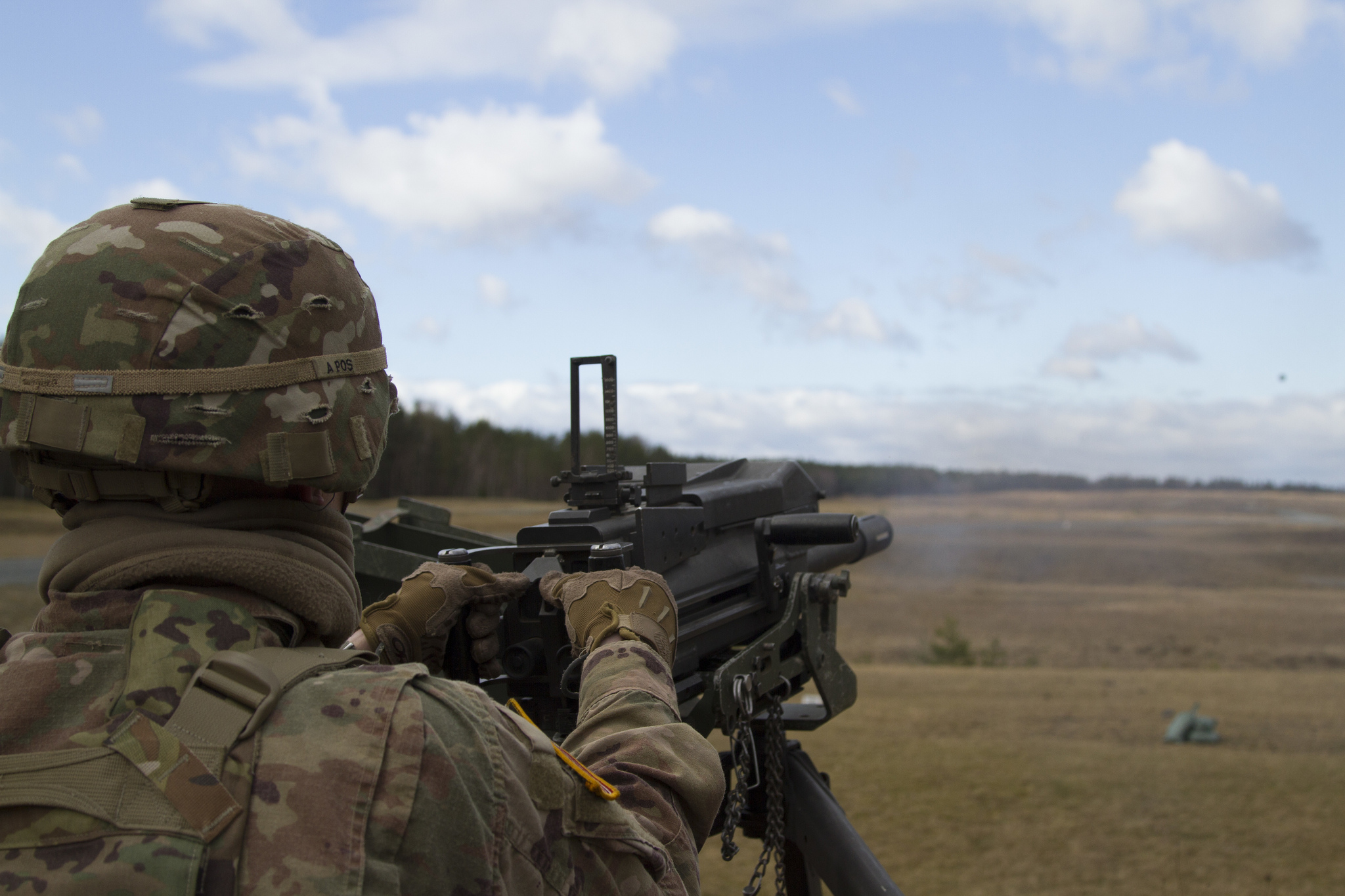 U.S. Army 1st Lt. Kevin A. Smith launches a grenade down range with the MK-19mm grenade machine gun March 13, 2019, at Grafenwoehr Training Area, Germany. (Spc. Yon Trimble/Army)