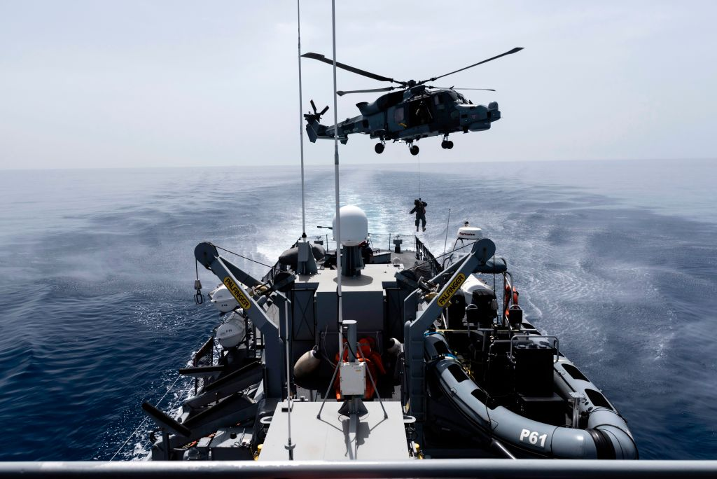A Royal Navy Lynx helicopter takes part in the