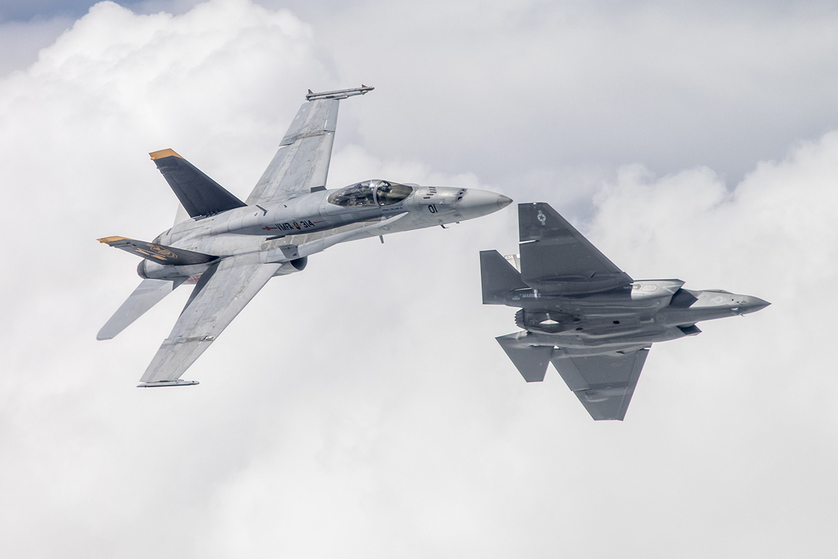 Capt. Tommy Beau Locke flies the first F-35C aircraft attached to the Black Knights of Marine Fighter Attack Squadron 314 over Naval Air Station Lemoore, Calif., in formation with an F/A-18A flown by Lt. Col. Cedar Hinton while