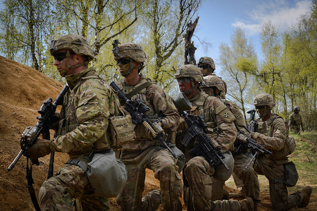 Soldiers from 3rd Armored Brigade Combat Team, 4th Infantry Division wait for orders to push forward toward the objective during Exercise Combined Resolve VIII at the Grafenwoehr Training Area, Grafenwoehr, Germany on April 24, 2017. The Army has canceled its program seeking an interim 7.62 mm rifle to replace some of its M4s. (Spc. Javon Spence/Army)