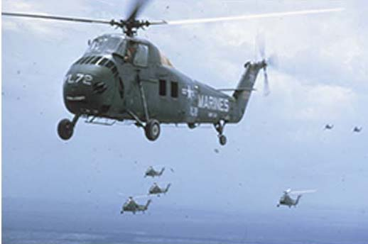A squadron of Marine helicopters flies over Vietnam, ca. 1964. This image originally appeared in National Geographic in 1966. (National Geographic; Wisconsin Historical Images ID 86877).