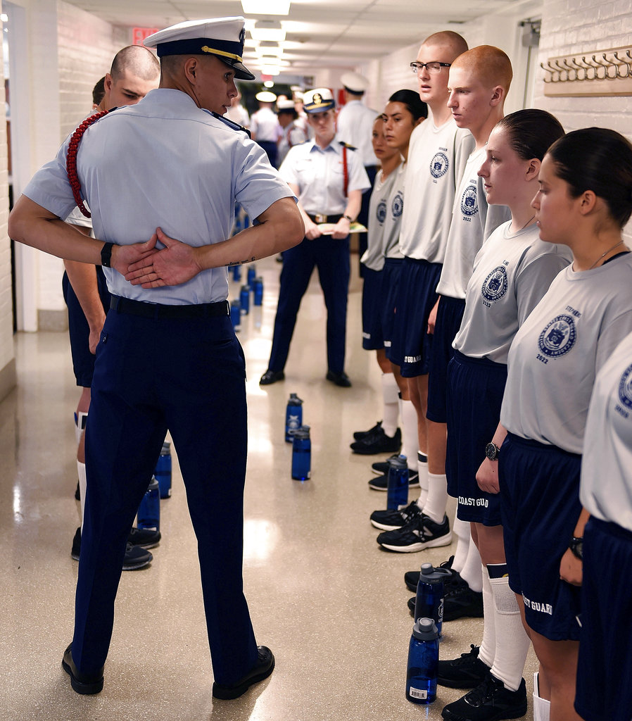 Cadet second class Joseph Rodriguez demonstrates parade rest for swabs of the U.S. Coast Guard Academy Class of 2022 during Day 1 of Swab Summer on July 2, 2018, at the academy in New London, Conn. (Sean D. Elliot/The Day via AP)
