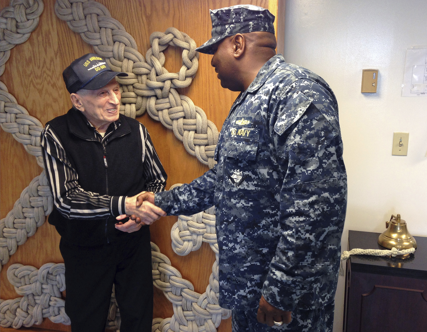 WWII veteran Edmund DelBarone, left, is greeted by Lt. Cmdr. Russell Goff during a tour at Naval Station Newport, in Newport, R.I., Thursday July 27, 2017. DelBarone, a 96-year-old World War II veteran, once dreamed of returning to a Navy installation to reminisce about his naval career, and help of a nonprofit it has become a reality. (Jennifer McDermott/AP)