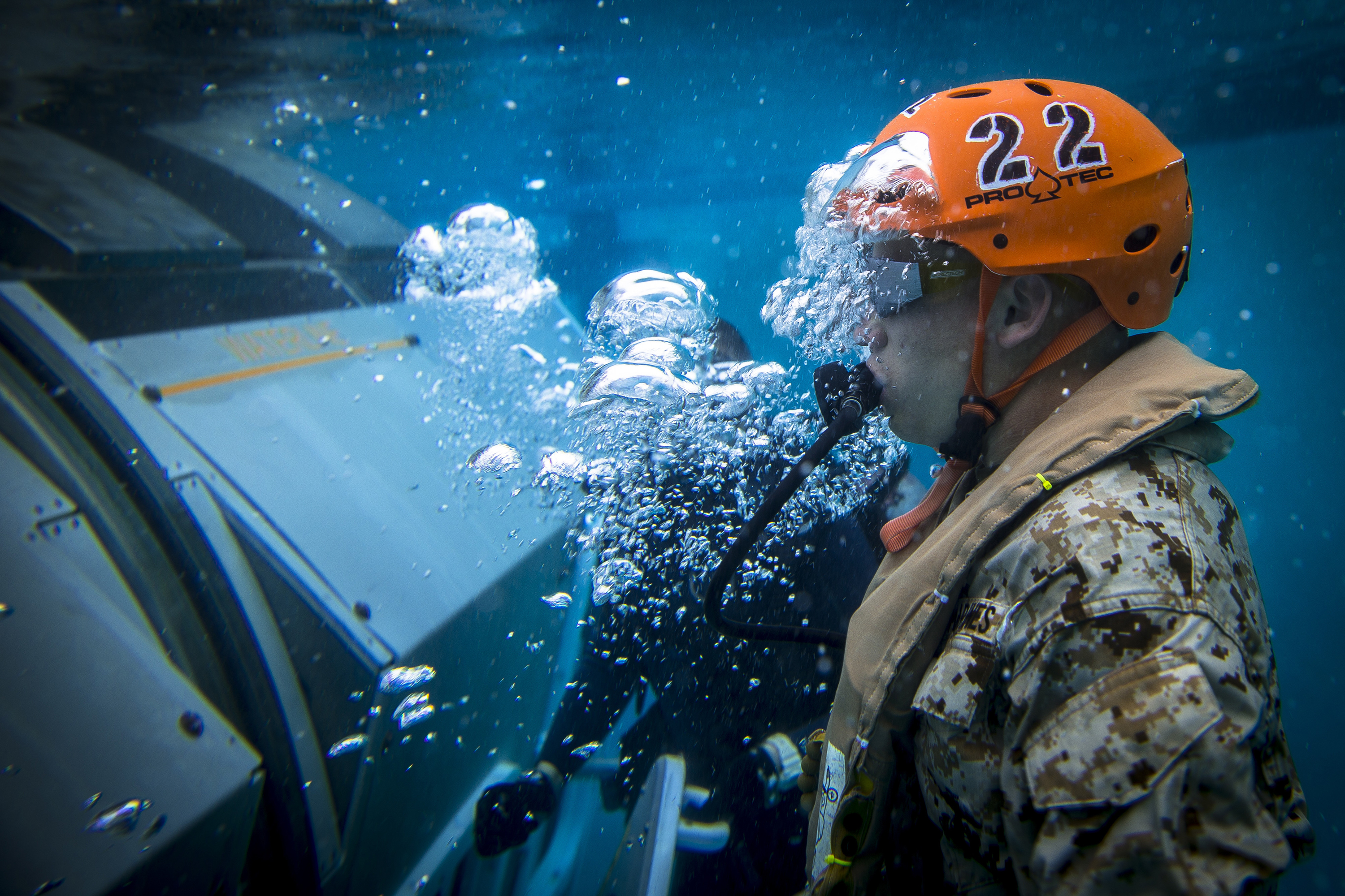 A Marine escapes from a Modular Amphibious Egress Trainer during underwater egress training at the Infantry Immersion Trainer facility on March 19, 2020, at Marine Corps Base Camp Pendleton, Calif. (Cpl. Dylan Chagnon/Marine Corps)